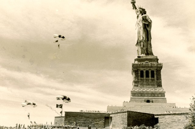 Sgt. Cheryl Sterns and members of the Golden Knights make their final approach as they prepare to make a historic landing at the base of the Statue of Liberty, July 1, 1978. (Sterns was the first female to join the team)