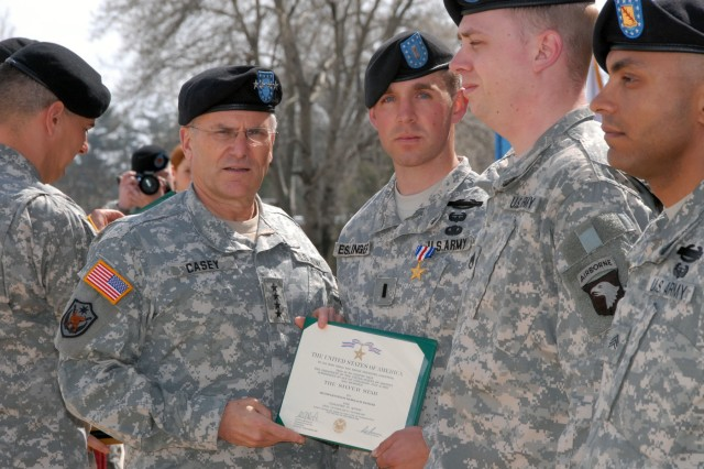 Gen. George W. Casey, U.S. Army Chief of Staff, poses with Silver Star recipient 1st Lt. Nicholas Eslinger, 1st Brigade Combat Team, 101st Airborne Division (Air Assault), on Fort Campbell, Ky., March 16. Casey pinned the award on Eslinger for gallantry in action while in support of Operation Iraqi Freedom. During Casey's visit, he talked with military spouses, dined with Soldiers and awarded medals to a select group of 101st Abn. Div. Soldiers.