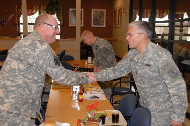 Gen. George W. Casey, U.S. Army Chief of Staff, shakes hands with a 101st Airborne Division (Air Assault) Soldier during a luncheon at the 101st Sustainment Brigade dining facility on Fort Campbell, Ky., March 16. During his visit, Casey talked with military spouses, dined with the troops and awarded medals to a select group of 101st Abn. Div. Soldiers.