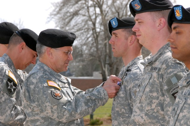 Gen. George W. Casey, U.S. Army Chief of Staff, pins the Silver Star on 1st Lt. Nicholas Eslinger, 1st Brigade Combat Team, 101st Airborne Division (Air Assault), on Fort Campbell, Ky., March 16. Eslinger received the award for gallantry in action while in support of Operation Iraqi Freedom. During Casey's visit, he talked with military spouses, dined with Soldiers and awarded medals to a select group of 101st Abn. Div. Soldiers.