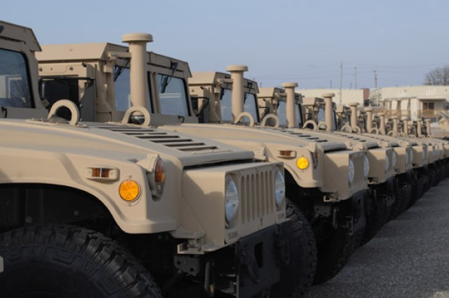 CUTLINE LINE: A line of M1165 High Mobility, Multipurpose Wheeled Vehicles wait for inspection by 4th MEB personnel.