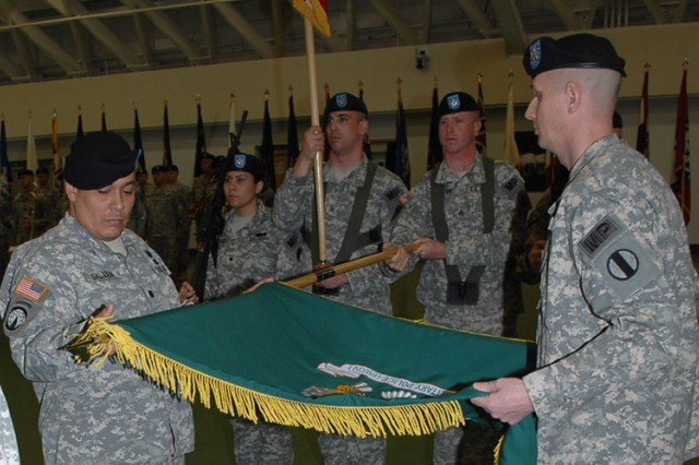 Cutline: Lt. Col. Jesse Galvan, 342nd MP Bn. commander, left, and Command Sgt. Maj. James Schultz rolled up the unit's colors during a ceremony, Friday, in Nutter Field House.