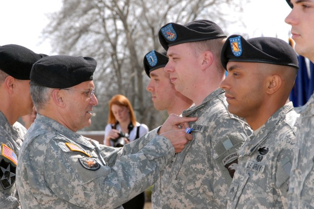 Gen. George W. Casey Jr., U.S. Army chief of staff, pins the Silver Star on Staff Sgt. Mark Quigley, 1st Brigade Combat Team, 101st Airborne Division, on Fort Campbell, Ky., March 16. Quigley received the award for gallantry in action while in support of Operation Iraqi Freedom.