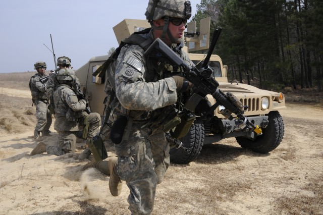 A Paratrooper from Company D, 1st Battalion, 325th Airborne Infantry Regiment, 2nd Brigade combat Team, 82nd Airborne Division, runs towards an objective during the brigade-wide mission readiness exercise. The MRE was a 10 day validation exercise to test the BCT's quick reaction force capabilities.