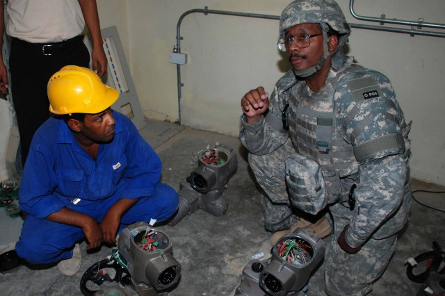 USACE project engineer Simeon Francis examines filter actuators as they are being cleaned at the Sadr R-3 Water Treatment Plant in Baghdad. The plant began operating in mid-June 2008 and was fully operational on September 27. Three months of post-commissioning O&M support was provided at the plant, which at full capacity outputs approximately 25 million gallons of clean, quality water a day.