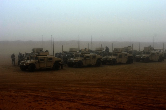 CAMP BUERHING, Kuwait - The military police platoon from 1st Brigade Special Troops Battalion, 1st Brigade Combat Team, 1st Cavalry Division, stages their vehicles in preparation for their training on the personal security detachment lane in Kuwait.