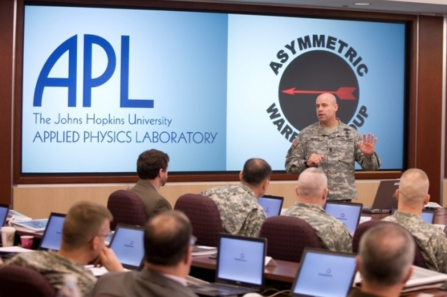 The Asymmetric Warfare Group Command Sgt. Major Ray Devens welcomes Army training developers, instructors, and leaders the Outcome Based Training & Education Integration Workshop, held March 5 and 6 at the Johns Hopkins University Applied Physics Laboratory campus in Laurel, Md.