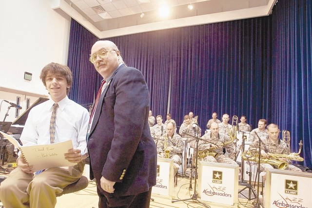 Jonathan Engleberg (left) poses with his composition teacher, Gary Daily - a former member of the U.S. Army Field Band Jazz Ambassadors - while the group rehearses at their Fort Meade, Md. studio on March 12. Engleberg composed a jazz piece that was recorded by the group last fall.