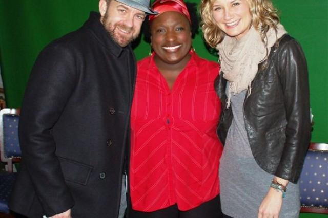 """U.S. Air Force Staff Sgt. Auchekia S. Miles, sang the Dutch National Anthem, known as the """"Wilhelmus"""", in Dutch to open the Sugarland concert in the Sporthal Rumpen, Brunssum, Netherlands, March 13, and is seen here with Sugarland's lead singers, Jennifer Nettles and Kristian Bush. Miles is known throughout the tri-border community for her singing talents and performs often at community events."""
