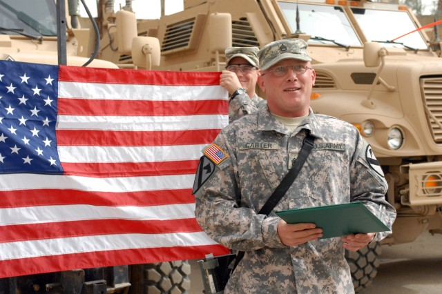 CAMP WAR EAGLE, Iraq - Cuba, Miss. native, Staff Sgt. Christopher Carter, a  Bradley fighting vehicle commander, gives a celebratory speech after reenlisting for an additional eight years March 13.  Carter currently has 12 years of service and plans to complete his military career serving the Army as needed.
