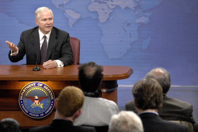 "Defense Secretary Robert M. Gates responds to a reporter's question during a press conference at the Pentagon, March 18. Gates announced a comprehensive plan to eliminate the current use of ""stop-loss"" policy while retaining the authority for future use under extraordinary circumstances."