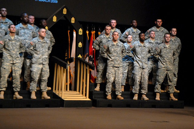 Combined Arms Center Command Sgt. Maj. Philip Johndrow delivers the charge to uphold Army and NCO Corps standards and traditions as new corporals and sergeants are inducted March 17 at the Lewis and Clark Center.