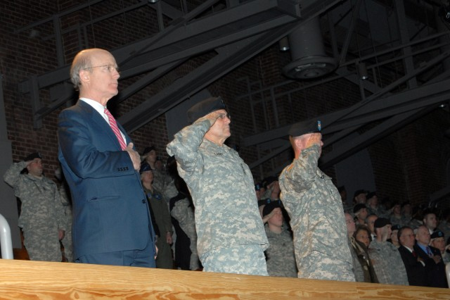 Secretary of the Army Pete Geren, Chief of Staff of the Army Gen. George Casey, and Sgt. Major of the Army Kenneth Preston render honors to the flag at a Full Honor Review held in honor of the Year of the NCO.