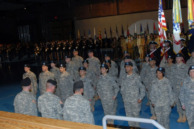 Twenty-nine Soldiers are inducted into the corps of non-commissioned officers by Sgt. Maj. of the Army Kenneth O. Preston.  The induction was part of the ceremony honoring the continuing contributions of NCOs in the Army.