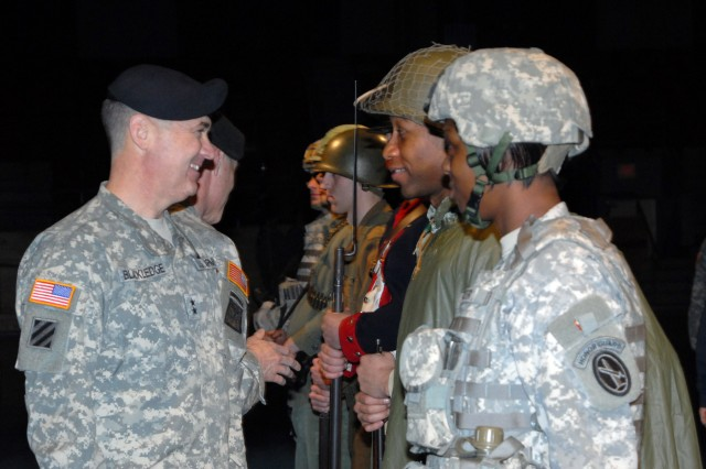 Maj. Gen. David Blackledge talks with Pfc. Erik Scott and Sgt. Wayndisha Parker after the review.  Scott represented Soldiers who served during the Korean Conflict, and Parker represented today's Soldier.