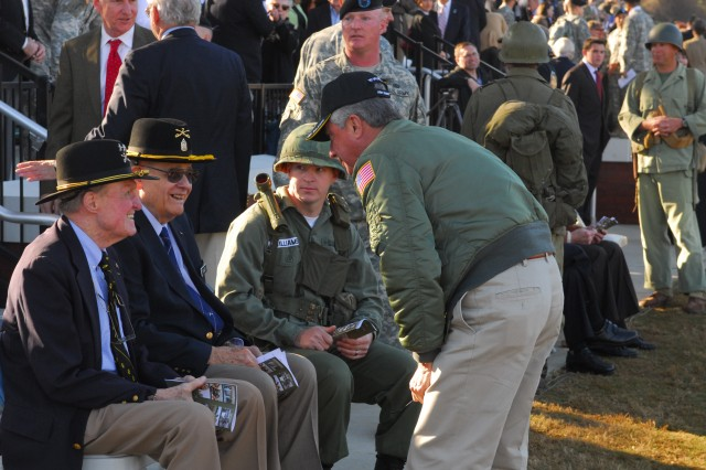 LTG(R) Hal Moore and CSM(R) Basil Plumley talk with a Sky Soldier Thursday after the Sacred Soil Ceremony.