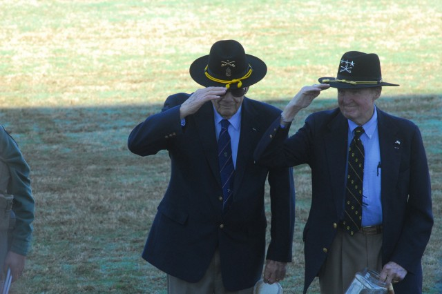 CSM(R) Basil Plumley and LTG(R) Hal Moore salute the crowd after sprinkling soil from LZ X-Ray during the Sacred Soil Ceremony Thursday on the parade field.  Moore and Plumley were the battalion commander and command sergeant major of the 1st Battalion, 7th Cavalry Regiment that fought the first major conflict of the Vietnam War.  It was made into the movie We Were Soldiers.