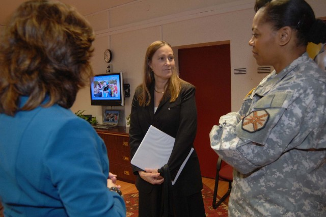 The Installation Management Command-Europe Region Director Diane Devens (center) talks with Mimi Azcarraga, The U.S. Army Garrison Kaiserslautern's Directorate of Human Resources director, and the garrison's Commander Lt. Col. Mechelle Hale March 17 at the garrison headquarters on Pulaski Barracks in Kaiserslautern. Devens visited the garrison's facilities before serving as the guest speaker for the garrison Women's Month 2009 Luncheon at the Kaiserslautern Community Activity Center on Daenner Kaserne.
