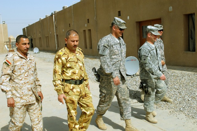 BAGHDAD - Members of Team Weasel and the 6th IA Div. walk to lunch at JSS Salam. The MiTT lives on the base with their Iraqi counterparts, allowing a very hands-on approach to their mission of combat advising.