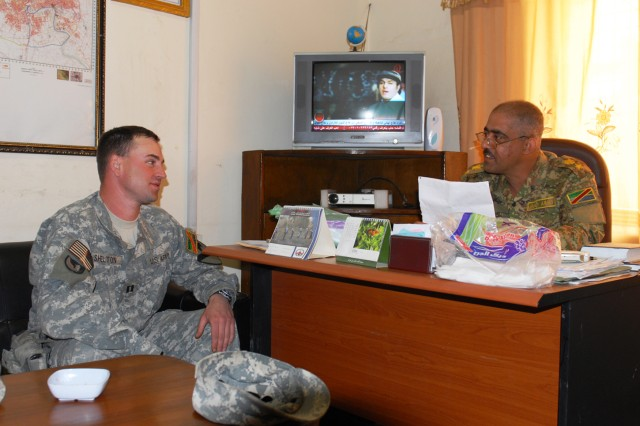 BAGHDAD - Capt. John Shelton (left), Team Weasel, 6th IA Div. MiTT, discusses day-to-day operations with Lt. Col. Haleem Jabir, executive officer, Engineer Regiment, 6th IA Div. Shelton, who hails from Wadsworth, Ohio, advises and assists the engineers of the 6th IA Div.