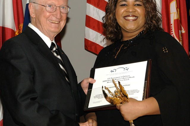 Dr. William McCorkle, Executive Director of the Aviation and Missile Research, Development and Engineering Center, presents Ms. Christina L. Brantley the 2009 U.S. Army Science Technology Engineering and Math Role Model Award at the Department of Defense 2009 National Women's History Month Outreach and Observance Program 19 March.  Brantley is an Electronics Engineer in AMRDEC's Weapons Development and Integration Directorate.  AMRDEC is an element of the U.S. Army Research, Development, and Engineering Command.