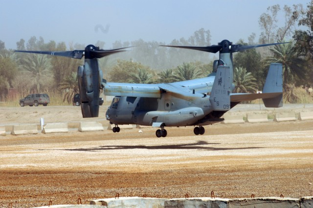 CAMP LIBERTY, Iraq - Like a helicopter, a Marine Corps MV-22B Osprey aircraft hovers over the Liberty Command Pad prior to touching down March 19 on Camp Liberty. Shortly after landing, the aircraft off-loaded a few Marines who were visiting senior leaders from the Multi-National Division-Baghdad.