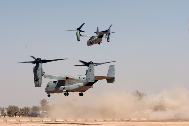 CAMP LIBERTY, Iraq - Two U.S. Marine Corps MV-22 B Osprey tilt-rotor aircraft take off from Liberty Command Pad March 19. When it comes to how it flies, the Osprey combines the best of both worlds with the ability to take off and land like a helicopter and the added feature of flying through the air like a plane.