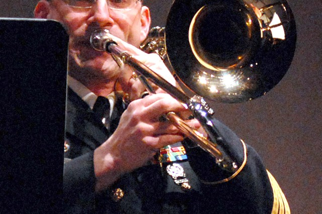"Sgt. 1st Class Christopher Rozmarin performs a solo trombone performance during the Army Ground Forces Band's Sousa, Stars and Stripes Forever! concert March 15. The band performed marches composed by ""the March King,"" John Philip Sousa, and classic works by Sousa's contemporaries."
