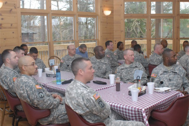 "Soldiers from the 8th Transportation Brigade and Surface Deployment and Distribution Command listen to a motivational speech by University of Richmond Spiders Football Coach Mike London March 10 at Brookwood Farms Barbecue Restaurant on Fort Eustis. ""It's a privelege and honor to speak to you guys,"" London said."