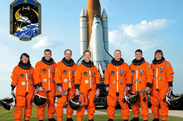 Astronaut Christopher J. Ferguson, mission commander, is at center; and astronaut Eric A. Boe, pilot, is third from the right. Remaining crew members, pictured from left to right, are astronauts Sandra H. Magnus, Stephen G. Bowen, Donald R. Pettit, Robert S. (Shane) Kimbrough and Heidemarie M. Stefanyshyn-Piper, all mission specialists.