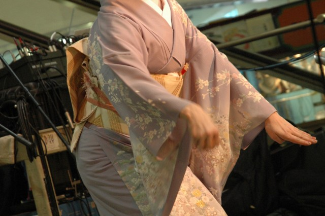 WAIKIKI, Hawaii - A geisha performs for a small crowd at the Waikiki Shopping Center, March 15, for the Honolulu Festival.