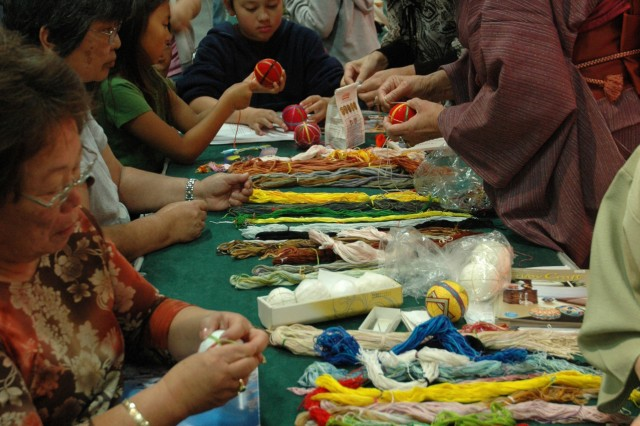 WAIKIKI, Hawaii - Participants join a craft table to participate in the Japanese folk art of making temari balls during the Honolulu Festival.