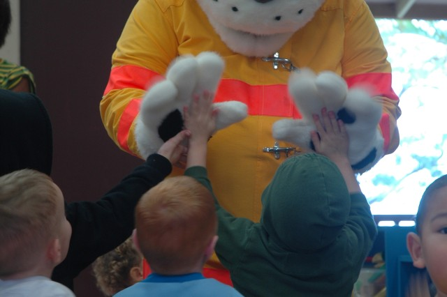 WHEELER ARMY AIRFIELD, Hawaii - Sparky, the Firedog, greets children at Wheeler\'s Armed Services YMCA during Playmorning, Feb. 25.
