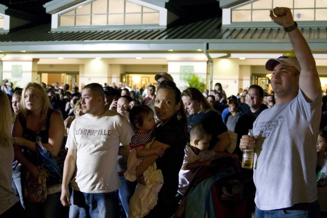 """SCHOFIELD BARRACKS, Hawaii - A crowd gathers around the stage outside the Nehelani during the """"Stryke Back Bash"""" for the 2nd Stryker Brigade, March 12. Musical guests kept the energy high and the crowd entertained throughout the night."""