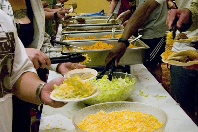 SCHOFIELD BARRACKS, Hawaii - Family members line up for free tacos provided by Just Tacos during the welcome back bash for the 2nd Stryker Brigade Combat Team, March 12, at the Nehelani.