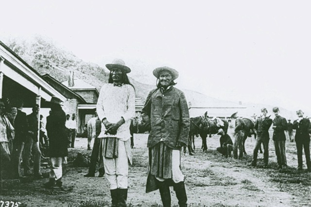 In this image are Natchez, the son of Cochise (left) and Geronimo, shown at Fort Bowie, Arizona, September, 1886 after the surrender to the U. S. Army. Photograph was done buy C. Fly of Tombstone, Arizona. ( Fort Huachuca collection).