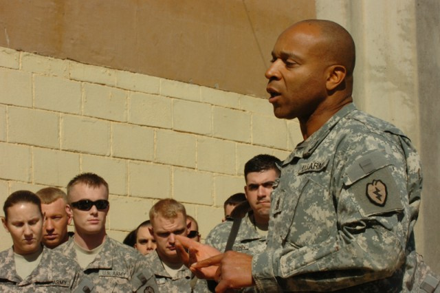 Sgt. Maj. John Garrison, G-2 Sgt. Maj., Information and Security Company, 25th Special Troops Battalion, 25th Infantry Division, speaks to Soldiers at a remembrance ceremony held on Contingency Operating Base Speicher, near Tikrit, Iraq, March 16. (U.S. Army photo by Pfc. Jesus J. Aranda, Task Force Lightning Public Affairs)