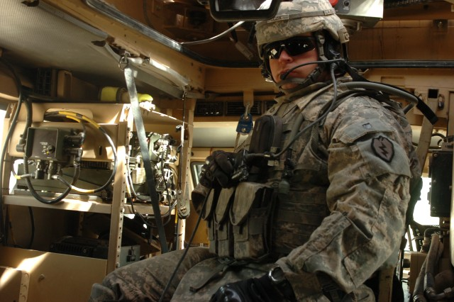 Pfc. Cody Cox, a Pearl, Miss. native and cannon crew member with 2nd Battalion, 8th Field Artillery Regiment, 25th Infantry Division, monitors his surroundings as the mine resistant ambush-protected vehicle, for which he is serving as the gunner, re-enters the entry control point at Forward Operating Base Warhorse, Mar. 21. (U.S. Army photo by Pfc. Jesus J. Aranda, Task Force Lightning Public Affairs)