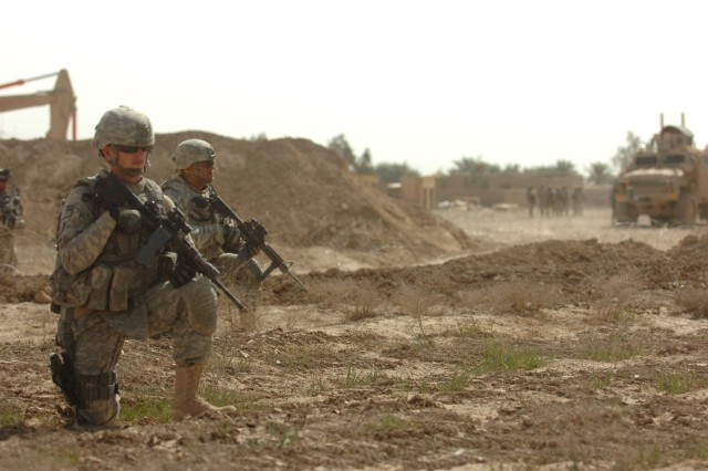 """Pfc. Kevin Robishaw, a combat medic and Coventry, R.I. native with Headquarters and Headquarters Company, 3rd Battalion, 66th Armored Regiment, 1st Stryker Brigade Combat Team, 25th Infantry Division, monitors the surrounding area intently as he and his fellow Soldiers pull security around the perimeter of Joint Security Station Diamond, Iraq, March 19. """"My overall job is to help keep our guys safe and assist the Iraqis so we can all go home safely,"""" said Robishaw. (U.S. Army photo by Pfc. Jesus J. Aranda, Task Force Lightning Public Affairs)"""