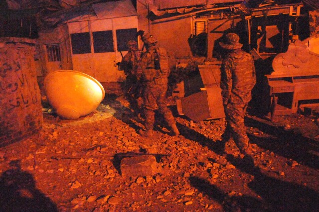 BAGHDAD - Paratroopers assigned to Battery A, 1st Battalion, 319th Airborne Field Artillery Regiment, 3rd Brigade Combat Team, 82nd Airborne Division, assess the damage after an indirect fire attack March 17 in the al-Karada district in eastern Baghdad.