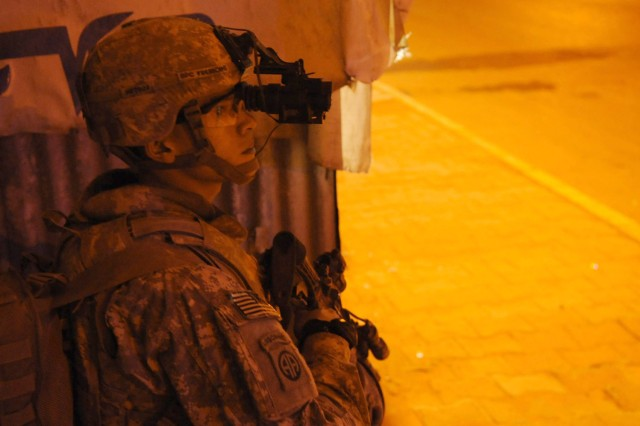 BAGHDAD - Spc. Jeffrey Frerichs, of California, Md., assigned to Battery A, 1st Battalion, 319th Airborne Field Artillery Regiment, 3rd Brigade Combat Team, 82nd Airborne Division, provides security after his platoon responded to a indirect fire attack March 17 in a Al Karradha district neighborhood.