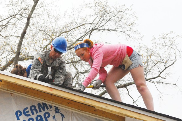 Nineteen Soldiers from the 11th Engineer Battalion helped build several Habitat for Humanity houses last week in south Columbus. They partnered with college students on spring break to provide housing for low-income families at a low, interest-free cost.