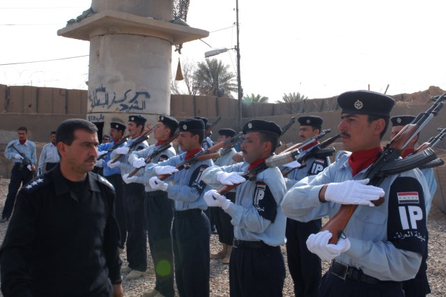An Iraqi Police Captain inspects a line of Iraqi Policemen practicing rifle drills prior to a ceremony transferring control of the Siniyah Joint Security Station from 2nd Battalion, 27th Infantry Regiment, 3rd Infantry Brigade Combat Team, 25th Infantry Division to the Iraqi Police March 8.