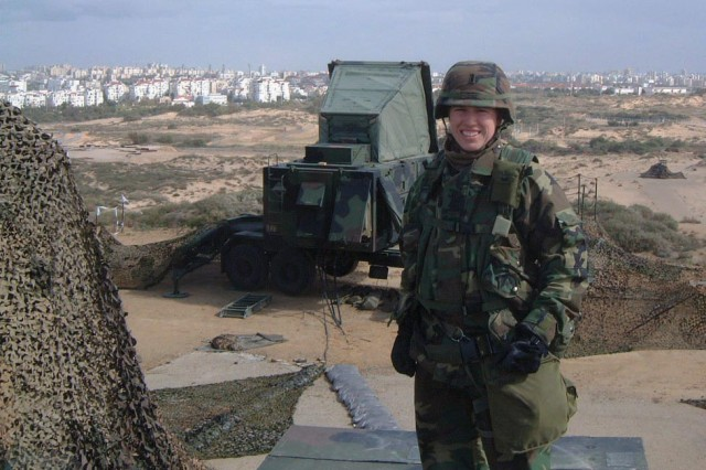 Capt. Amanda Clare stands before the city of Tel Aviv, Israel, in 2003. While in Tel Aviv she served in the Army as a first lieutenant Patriot missile officer.
