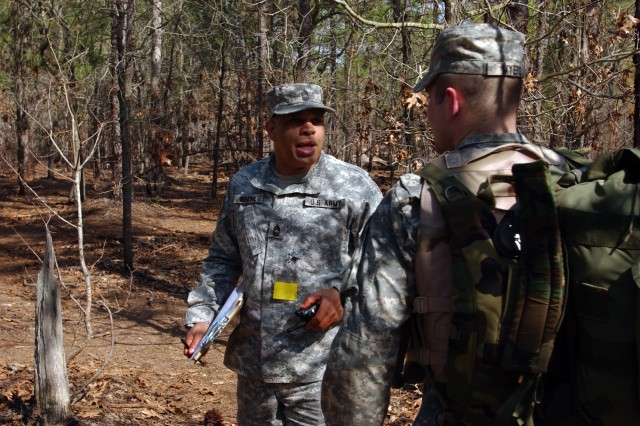 FORT JACKSON, S.C. - Master Sgt. Terry Mahone, the 81st Regional Support Command senior medic, talks with Sgt. Tyler Meyers, from the 100th Army Band, after the medical warrior task portion of the 81st RSC's Best Warrior Competition held here March 20-22. The competitors were competing for spots in next month's regional competition held here.