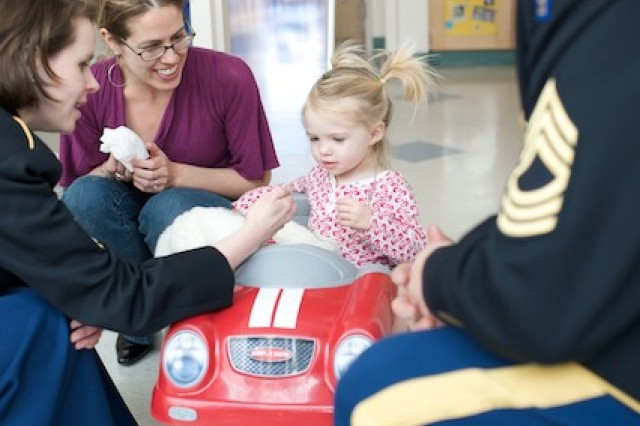 United States Army Field Band Soldier-musicians MSG Bill Elliott and SFC Erica Russo interact with patients at the Barbara Bush Children's Hospital in Portland, Maine, March 22, 2009.