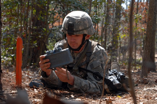 Spc. Jeremiah Rice, Company A, 4th Battalion, employs a claymore mine during the pretesting portion of EIB.  Rice earned his EIB after 16 days of training and testing at Fort A.P. Hill, Va.
