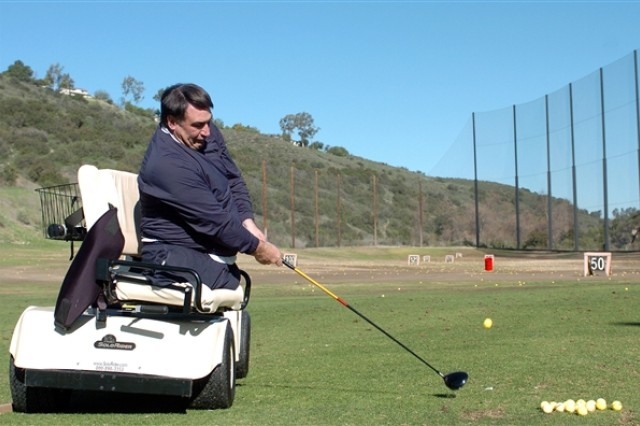 First Swing instructor Marty Ebel demonstrates how to drive a golf ball from a specialized cart during a golf clinic for wounded warriors on the driving range at Admiral Baker Golf Course in San Diego in February 2009. The next stop on the tour is March 22 and 23, 2009, at Fort Belvoir, Va.