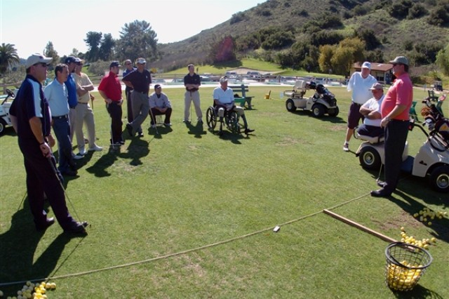 Army Family and Morale, Welfare and Recreation Command program analyst and Professional Golfers' Association member Trace Kea, far right, discusses working with disabled soldiers during a First Swing train-the-trainer session at Admiral Baker Golf Course in San Diego in February 2009