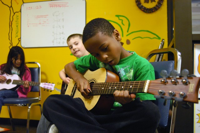 Izaiah Thompson, 8, takes beginner guitar lessons at SKIESUnlimited at Fort Campbell, Ky.